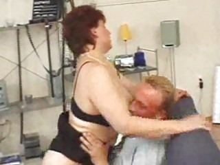 aged redhead sucks and licks and spits on sex-toy
