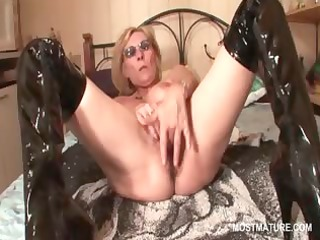 aged in latex boots masturbating pussy with