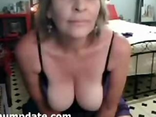 brunette hair aged chick with big tits teasing