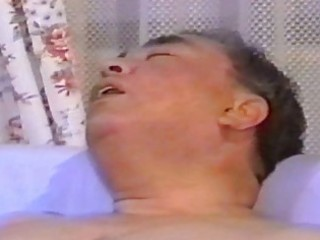 oriental aged guy masturbates on sofa