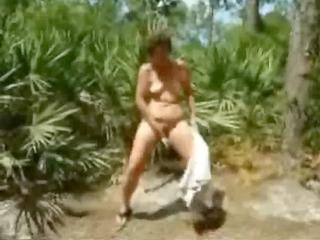 pervert older streep tease in forest. amateur