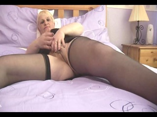 curvy older with shaggy snatch in open girdle
