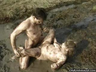 lascivious old mom overspread with mud riding