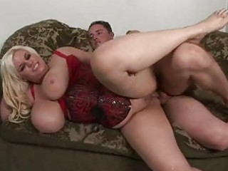 Blonde momma with massive jugs in red corset gets