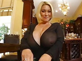 enormous chested blond momma doing a pov blowjob