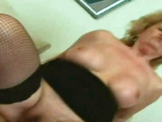 golden-haired granny engulfing and fucking a cock