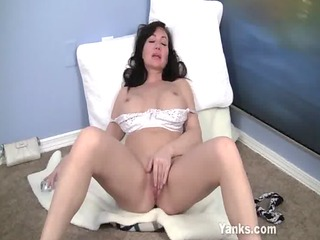 youthful looking milf plays with pussy and tits