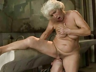 breasty granny gets drilled in public toilet