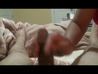 indian wife gives oily tugjob with a cheerful