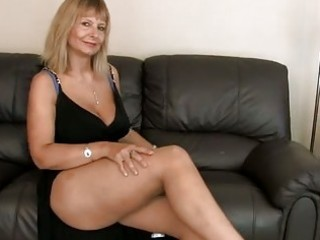 breasty mature fingering her curly snatch