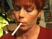 kira red aged german plumper smokes a cigarette