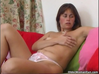 curly and aged mamma masturbates with fingers and